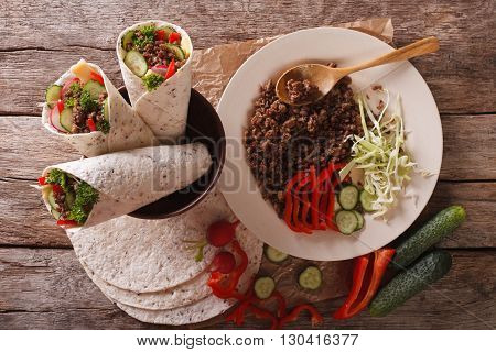 Sandwich Roll With Beef And Fresh Vegetables. Horizontal Top View