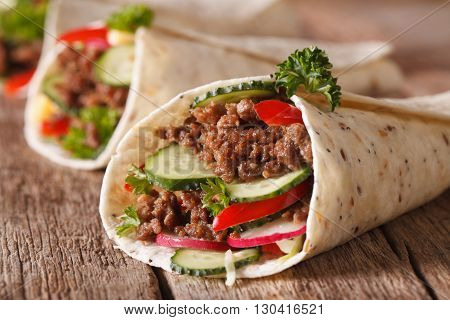 Sandwich Roll With Beef And Fresh Vegetables Macro. Horizontal