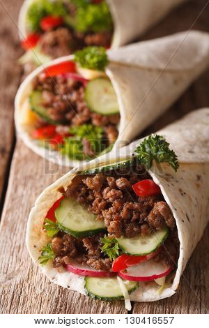 Sandwich Roll With Beef And Fresh Vegetables Macro. Vertical