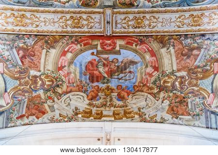 Santarem, Portugal. September 11, 2015: Baroque frescoes in the ceiling of Hospital de Jesus Cristo Church. 17th century Portuguese Mannerist architecture called Chao. Santarem, Portugal