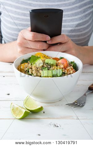 Woman taking a picture to food with a mobile phone