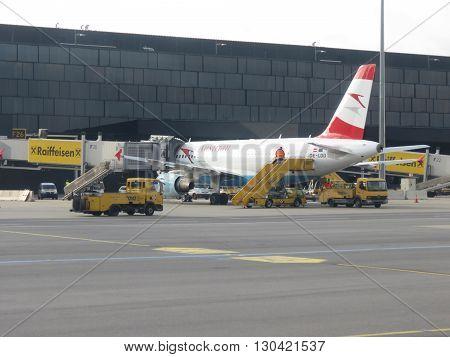 VIENNA SCHWECHAT AUSTRIA - CIRCA NOVEMBER 2014: Austrian Airlines aircraft at the airport
