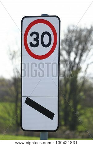 30 mph UK road sign with 100 yard countdown marker