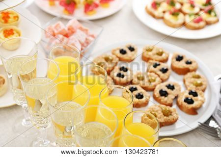 Set of cold snacks, canape, beverages, closeup