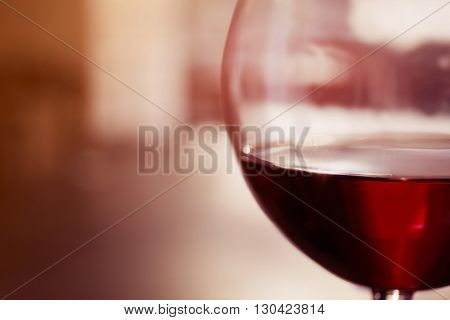 Glass of red wine on blurred background
