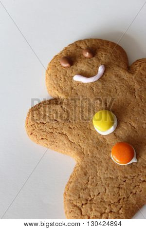 Gingerbread man lying on a white background ready to eat
