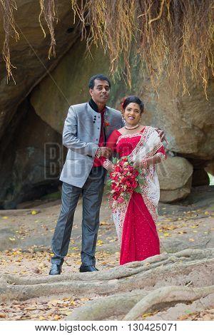 ANURADHAPURA, SRI LANKA - MARCH 13, 2015: Newlyweds on Vessagirii ruins. Wedding photo shoot in the ancient capital of Anuradhapura