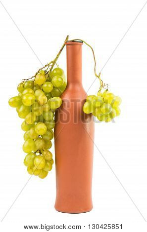 grapes with a bottle isolated on a white background