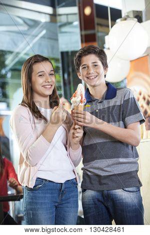 Brother And Sister Having Vanilla Ice Cream