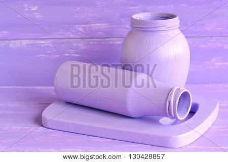 Painted glass jars and cutting board. Handmade home decor ideas. Handmade kitchen design ideas. Lilac background