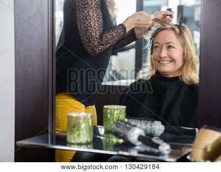 Woman Getting New Hairstyle In Beauty Parlor