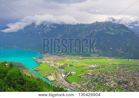 Aerial view of the city district and Interlaken Ost railway station. Switzerland.