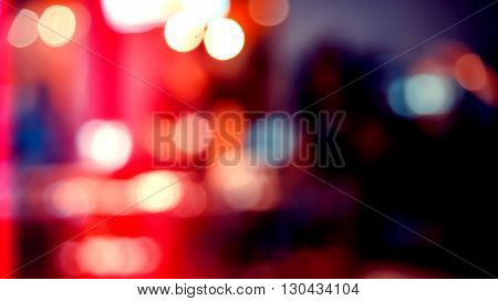 Blurred defocused of light in pub city abstract background