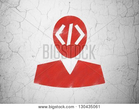 Software concept: Red Programmer on textured concrete wall background