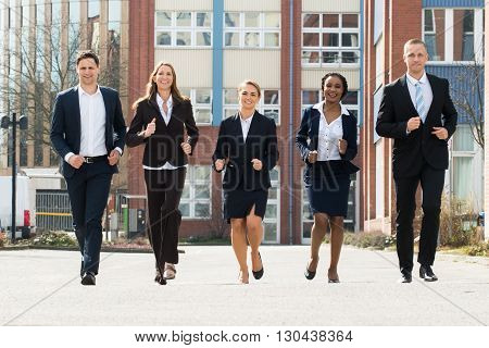 Group Of Businesspeople Running Together In Race Competition