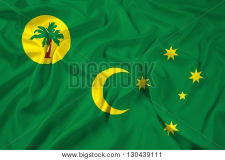 Waving Flag of Cocos Islands, with beautiful satin background