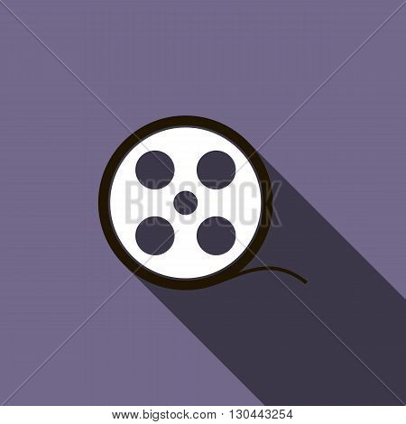 Film reel icon in flat style on a violet background
