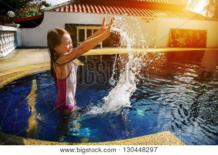 Little girl having fun in the pool. Thailand Phuket