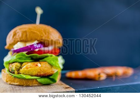 Shrimp burger with fresh vegetables
