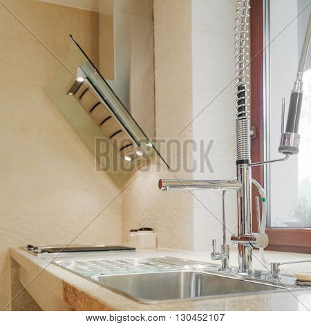 Close up of solid kitchen sink and worktop