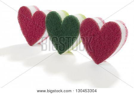 Heart shaped dishwasher sponges isolated on white background.