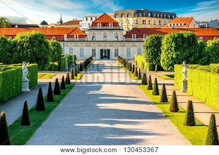 View on Lower Belvedere palace with park alley in Belvedere historic building complex in Vienna.