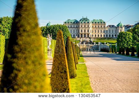 View on Upper Belvedere palace with park alley in Belvedere historic building complex in Vienna.