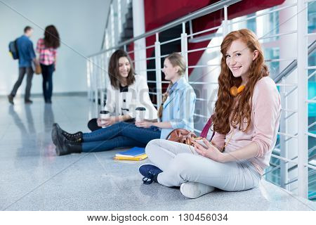 Students sitting on the floor and waiting for lecture