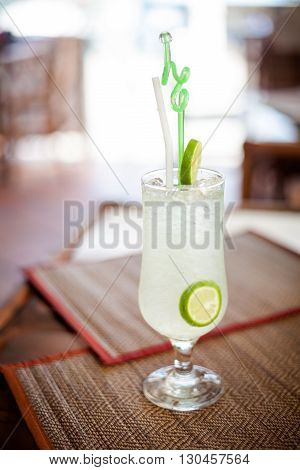 Freezing cold lime margarita. Traditional drink served with lime.