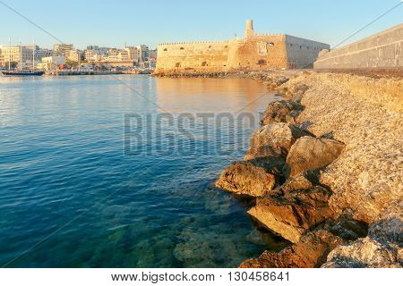 A view of the Venetian Fortress and the port of Heraklion in the early morning. Crete.