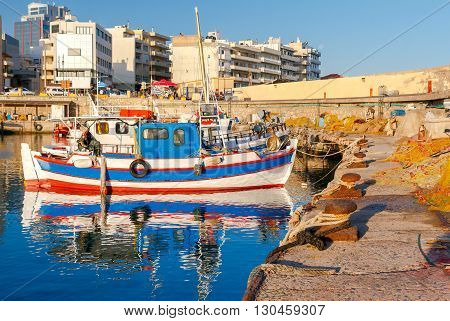 Fishing multi-colored boats in the old harbor of Heraklion in early sunny morning. Crete, Greece.
