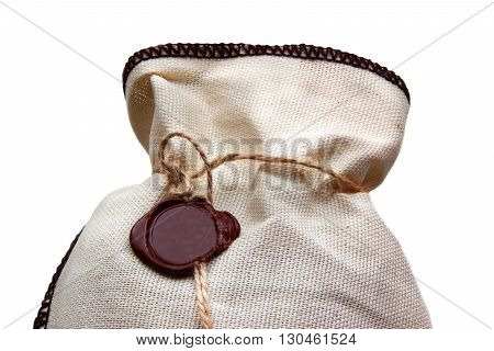 Linen bag with brown wax seal isolated on white