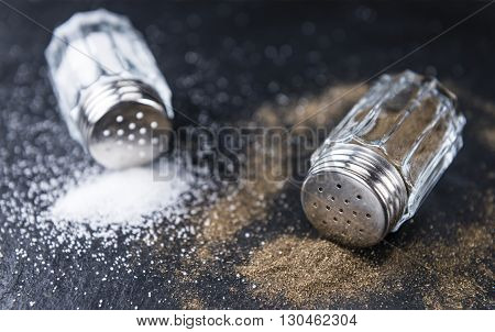 Salt And Pepper Shakers On A Slate Slab
