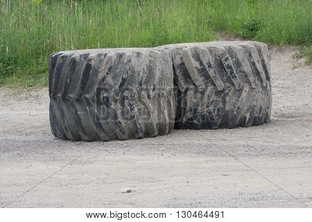 Giant Machinery Rubber Tires laying in a field
