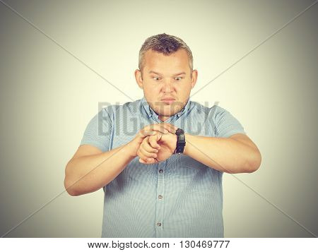 Fat Businessman Late For Work, Looking At His Watch