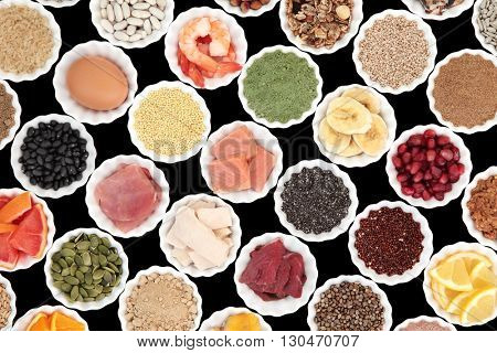 Health and body building high protein super food of meat, fish, dairy, supplement powders, grains, cereals, pulses, seeds, fruit and vegetable selection.