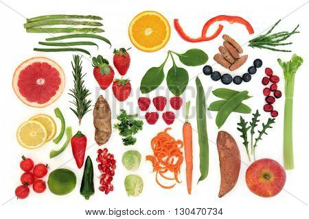 Paleolithic diet health food of fruit and vegetables over white background. High in vitamins, antioxidants, minerals and anthocyanins.