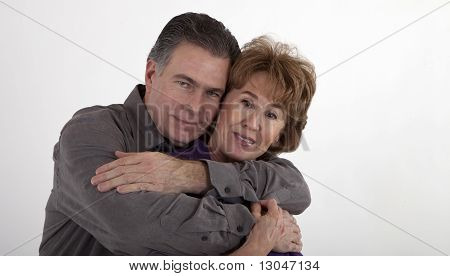 Older Couple In Playful Embrace