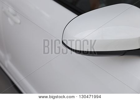 rear side mirror of new white car