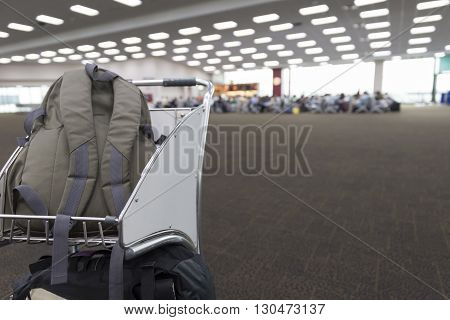 Rucksack On Cart In Airport Terminal Building