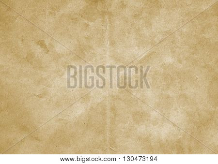 Aged dirty paper background for the design. Grunge paper texture.