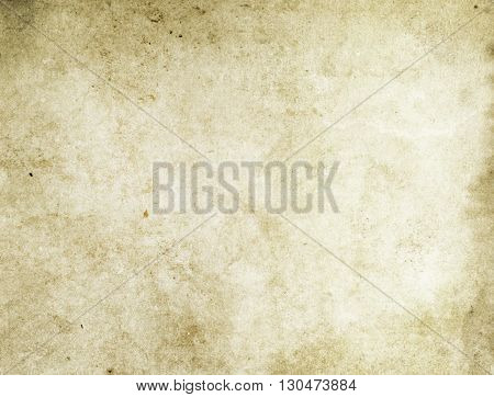 Aging paper background. Natural old paper texture for the design.