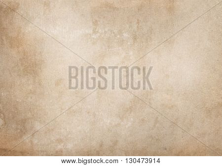Aged paper background. Natural old stained paper texture for the design.