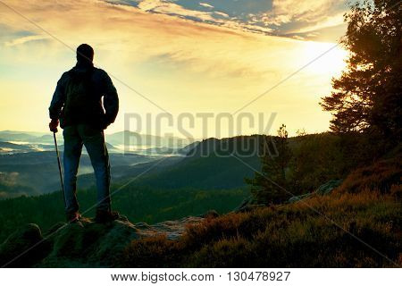 Silhouette Of Tourist With Backpack. Sunny Spring Daybreak In Rocky Mountains. Hiker With Sporty Bac