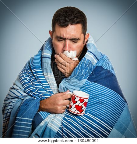 Portrait of a sick man with the flu, allergy, germs,cold coughing