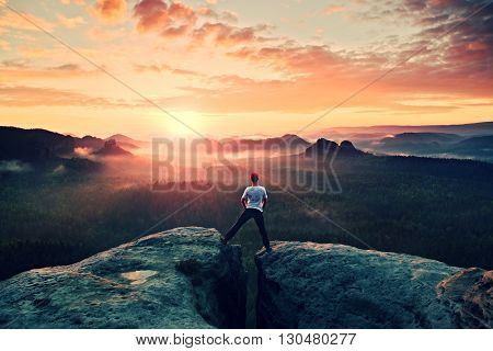 Crazy Jumping Hiker In Black Celebrate Triumph Between Two Rocky Peaks Above Mist.. Wonderful  Autum