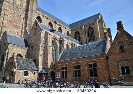 Bruges Belgium - May 11 2015: People at The St. Salvator's Cathedral in Bruges Belgium. The Sint-Salvator Cathedral is the main church of the city.