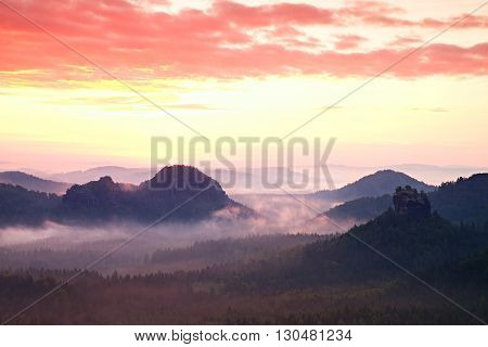 Red Daybreak. Misty Daybreak In A Beautiful Hills. Peaks Of Hills Are Sticking Out From Foggy Backgr