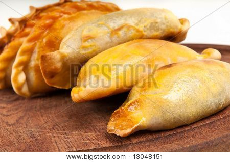 Empanada Close Up Over Wooden Table.