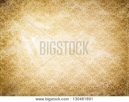 Grunge paper background with old-fashioned floral ornament.